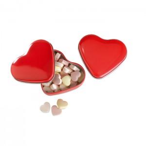 Cukorka szív alakú tartóban